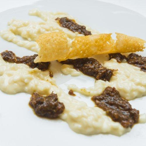 Il risotto mantecato al Franciacorta con ragù di faraona e tartufo estivo di Beppe Maffioli del Carlo Magno